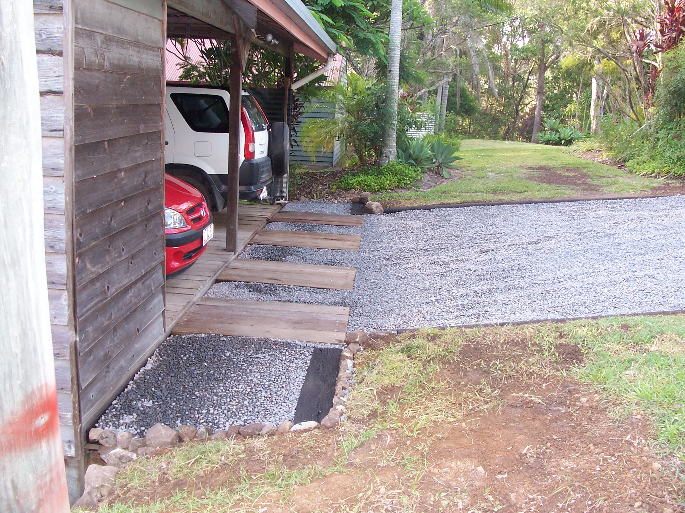Don's Expert Answers:  Blue metal in front of garage on a slight slope. Cars get bogged or dig it up when reversing is there something we can add to make it hard.